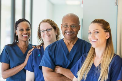 Man leading team of multi-ethnic nurses