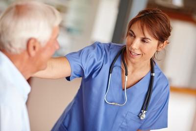 nurse with hand on patient's shoulder