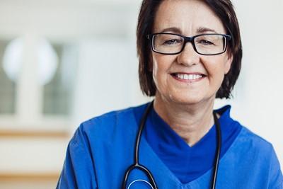 older nurse smiling