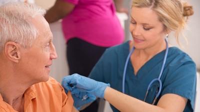 nurse giving immunization